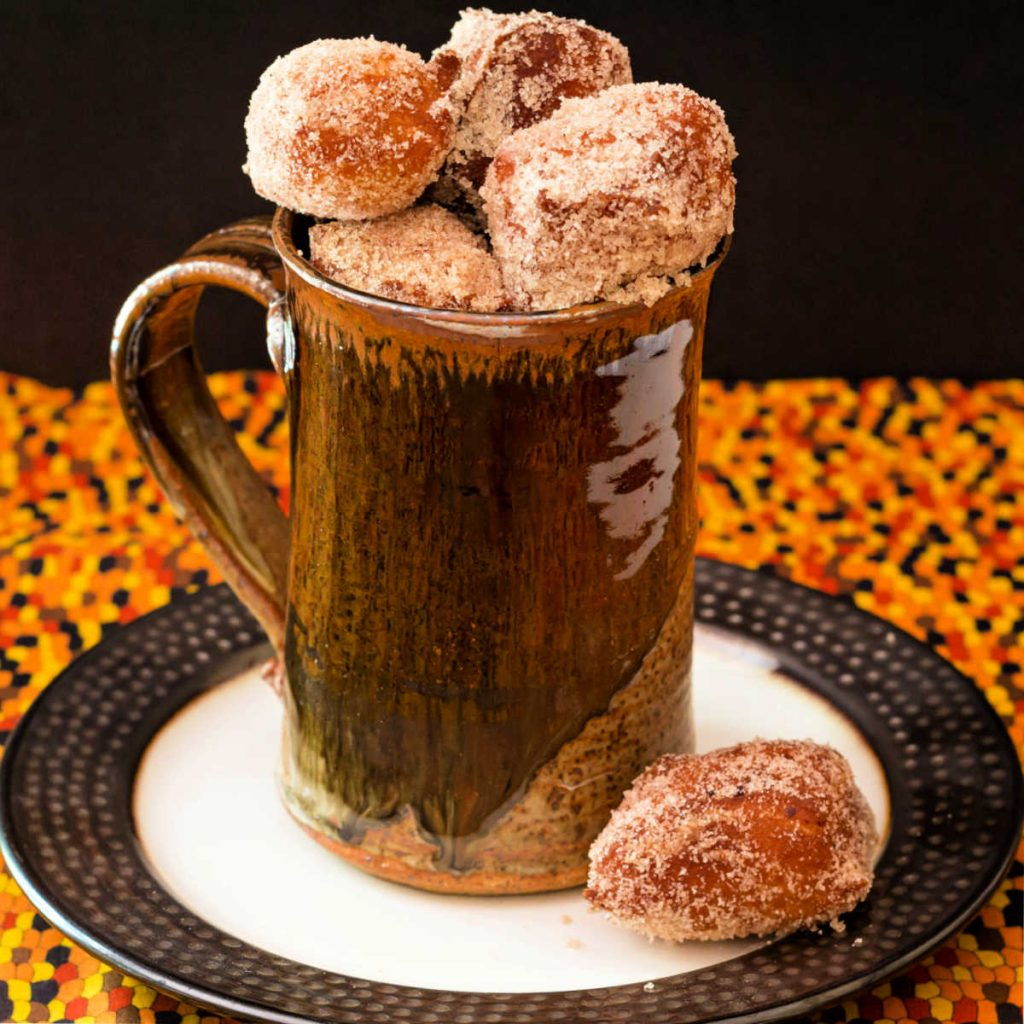 brown mug full of pumpkin donut holes