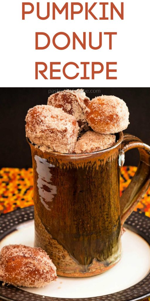 "mug with pumpkin donut holes in it text reads ""pumpkin donut recipe"""