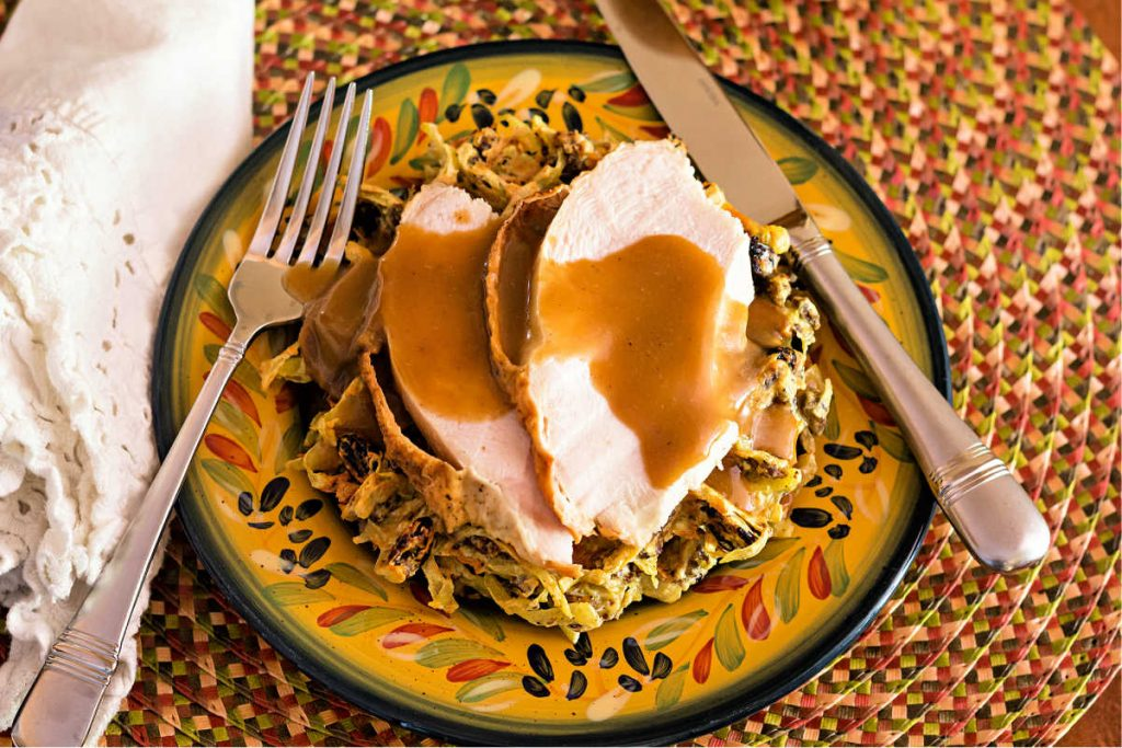 Stuffing waffles with roast turkey breast and gravy on top.