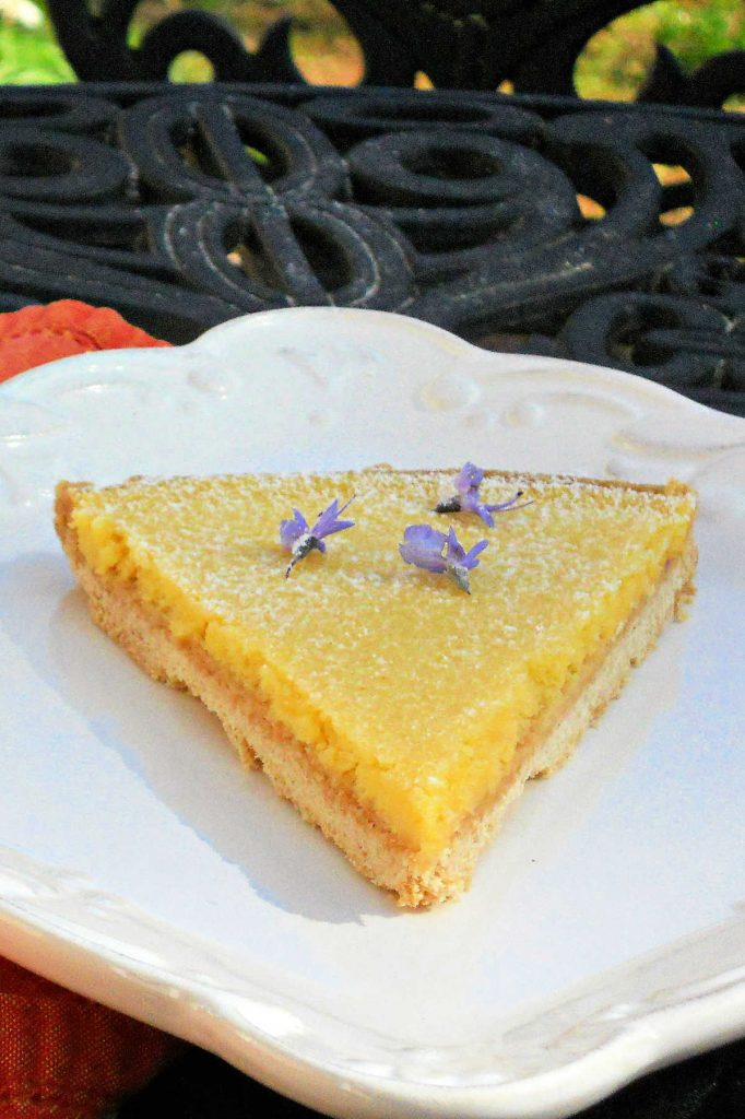 A slice of sabayon tart on a white plate.