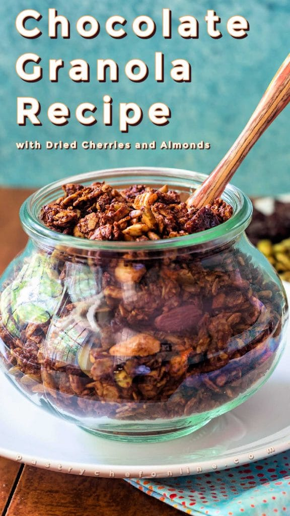 """Jar of granola. Text reads """"chocolate granola recipe with cherries and almonds."""""""