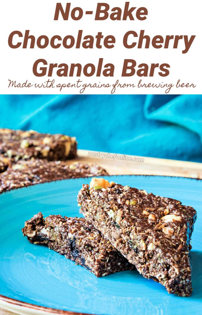 """A no-bake granola bar cut into 2 triangles on a blue plate. Text reads, """"No-Bake Chocolate Cherry Granola Bars made with spent grains from brewing beer."""""""