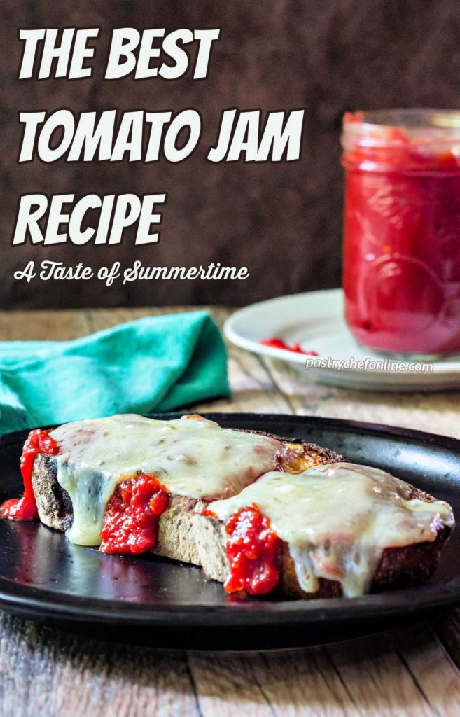 """A piece of toast on a black plate with tomato jam dripping down the sides with melted white cheddar on top. There is a jar of tomato jam in the background. Text reads, """"the best tomato jam recipe. A taste of summertime."""""""