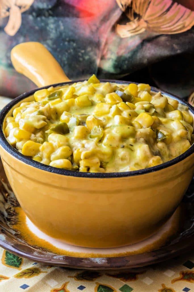 A yellow crock full of deviled corn.